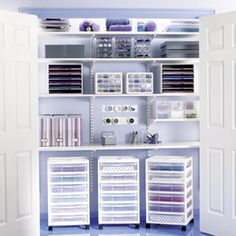 Lots of flexible storage in this closet - nice purple wall softens the look and adds some interest. Shelf as worksurface. Closet doors close off at any time.