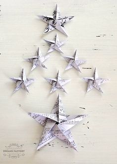 French DIY Paper Stars Ornaments | Welcome your tree by adorning it with a paper decorations DIY tutorial that will make it feel right at home.