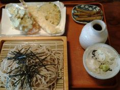 Soba set consists of noodles, tempura, pickles.
