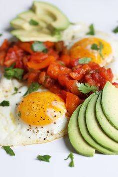 Huevos Rancheros- is typically served atop a corn or flour tortilla and with refried beans.
