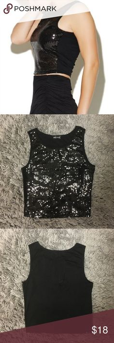 Black Sequin Sleeveless Crop Top Cute black sequin crop top. Goes with almost everything and makes your outfit pop! #GirlyAndFlirty 😉 Would be more fitted on a medium. Used twice. Wet Seal Tops Crop Tops
