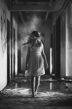 As she walked through the ruins, she remembered what it was like living there. She could almost smell her mother's perfume radiating of off the furniture.