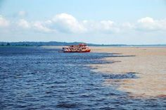 A great shot of the blue waters of the Tapajos River meeting with the muddy waters of the Amazon.