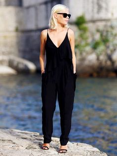 A sleek jumpsuit and strappy heels is sexy and put-together. // #Fashion