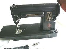 Vintage Singer Sewing Machine 301A with book and accessories
