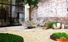 Behind a Brooklyn townhouse, the client envisioned a simple gravel court, a seating area, and a low-maintenance garden. The design delivers that and more: espaliered flowering trees and mossy fairy rings.