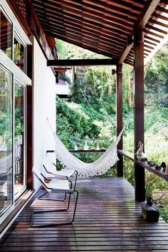 Sweet hammock on the covered porch, perfect spot to spend a rainy afternoon without getting wet.