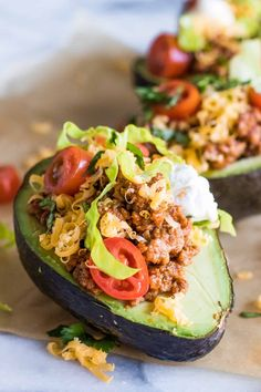 Close up of halved avocado stuffed with taco meat, cheese, lettuce, tomato and sour cream. dinner avocado Keto Dinner Recipes For Those Nights You Have Zero Time Low Carb Recipes, Diet Recipes, Cooking Recipes, Healthy Recipes, Recipes Dinner, Quick Recipes, Cooking Ideas, Clean Eating, Healthy Eating