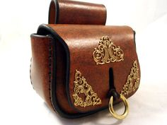 Up for sale is one Handmade Medieval or Steampunk type Brown Leather Belt Pouch. This pouch is made of thick leather and hand stitched to last for years. I take great pride in my workmanship and I make my leather products to last.    I use a saddle stitch in my projects rather than a lock-stitch. This ensures that if at some point in the future a stitch breaks or gets worn only that stitch will be loose on that side. The rest of the stitches will remain intact.    I also use a polyester threa...