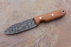 Bushcrafter HC from L.T. Wright Handcrafted Knives. High carbon steel, convex grind, and a two-step patina make this knife a great choice for in the field. And at $75 for the knife, it's a great deal!