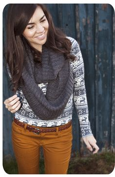 i'd rock: tan jeans (old navy).  grey scarf (made by me).  gotta get a rockin' sweater like this!