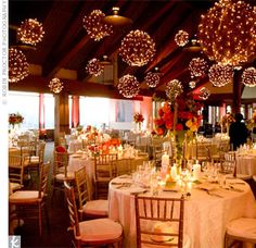 Guests gathered at a popular Aspen restaurant for the couple's reception. The room was transformed into a sparkling wonderland. Twinkling twig orbs hung from the ceiling and fuschia lights illuminated the walls. Sheer ivory linens were draped over the tables chairs.