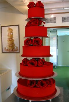 Red Velvet wedding cake with buttercream frosting,   layers of strawberry crème Brûlée /filling and Vanilla buttercream filling. Follow RUSHWORLD on Pinterest for wedding cakes, fashion and fun!
