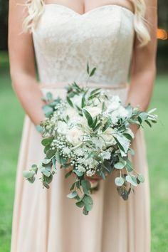 Organic ivory rose, baby's breath and eucalyptus wedding bouquet: http://www.stylemepretty.com/california-weddings/2016/12/21/outdoor-fairytale-wedding/ Photography: Natalie Bray - http://nataliebray.com/