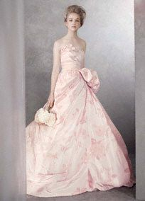 """Floral-print taffeta ball gown with draped bodice.  Floral-print taffeta ball gown with asymmetrically draped bodice, swagged skirt, and side peplum.  Gown features ruched waist and exposed-tulle train.  Available in select stores in Ivory and Pink Print.  Sizes available 0-14.  Train 58 1/2"""" from waist. Fully lined. Center back zip. Imported. Dry clean only.  NEW! See Vera's inspiration Behind the Dress"""