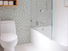 Designer Jennifer Jones transforms a small, cramped bathroom into an open and functional space by rearranging the floor plan and using bright white finishes on HGTV.com.