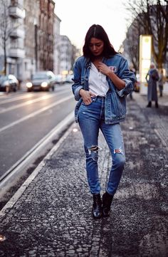 Borrowed from the boys. Layer an oversized denim jacket on top of a classic, white button-down shirt and jeans for a fresh spin on double denim. As seen at Berlin Fashion Week. Photo: Eye Candy Berlin.