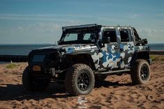 "siny4wdclub: ""Member @the_punisher_jk taking his blue camo wrapped JK to the beach this Labor Day weekend! : @filteredeyephotography #jkusquad #sevenslotbattalion #jeepfortress #jeepporn #jeepownersofamerica #instajeepthing #picoftheday #jeep..."