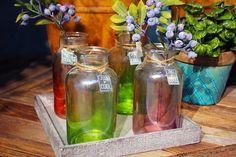 #Vasetti di vetro colorati con #bacche.