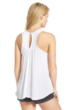 Free shipping and returns on Threads Studio Embroidered Tunic (Juniors) at Nordstrom.com. Pretty embroidery centers a lightweight stretch racerback tank shaped by cutaway armholes and a gently flared silhouette.