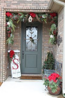 Cali nature Christmas front door greenery/ decor... Magnolia leaves for me and instead of sled... ?