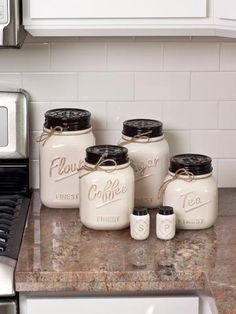 The Off White Canister Mason Jar set of 4 adds adorable country charm and style to your kitchen decor. This set of four includes, flour, sugar, coffee and tea.