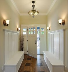 Elegant use of Tiffany ceiling light in an elegant modern entry way to a home.
