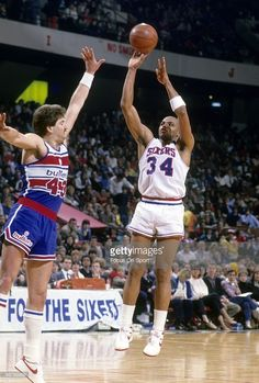 PHILADELPHIA, PA - CIRCA 1980's: Charles Barkley #34 of the Philadelphia 76ers in action shooting over Jeff Ruland #43 of the Washington Bullets during a mid circa 1980's NBA basketball game at the Spectrum in Philadelphia, Pennsylvania. Barkley played for the 76ers from 1984-92.