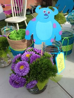 Monsters Inc baby shower centerpieces. Wild flowers, mason jars and Sulley!