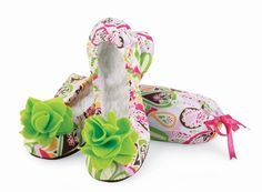 What girl wouldn't love these adorable slippers?    Vivid paisley print slippers made of cotton with a plush lining and pink felt flower. Comes complete with matching drawstring carry pouch.