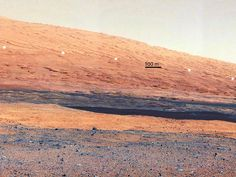 """Getting to Know Mount Sharp  This image taken by the Mast Camera on NASA's Curiosity rover highlights the interesting geology of Mount Sharp,  inside Gale Crater, where the rover landed.   The train of white dots may represent an """"unconformity,"""" or an area where the process of sedimentation stopped.   Image credit: NASA/JPL-Caltech/MSSS"""