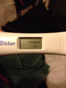 positive pregnancy test black hand with nails