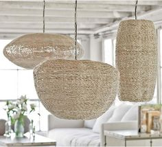 Woven pendants make the space feel casual, add an organic element and offset the sleekness of the countertops.