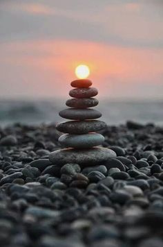 The arrangement of the rocks let them balance on one another. The photographer uses depth of field, texture, and is taken at worms eye view.