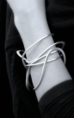 Liliana Guerreiro | Squiggle Bangle - elegant simplicity; chic statement jewellery - Don't be tricked when buying fine jewelry! Follow the vital rules at http://jewelrytipsnow.com/a-simple-guide-to-purchasing-fine-jewelry/