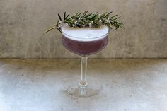 Rosemary Blueberry Gin Sour - Today I am sharing a lovely cocktail inspired by my favorite herbal serum. Jurlique hails from South Australia where they own their own certified organic farm. This serum is made with 18 potent botanicals including peppermint, rosemary, chamomile, and many more. I am highlighting beautiful rosemary in this gin cocktail today.