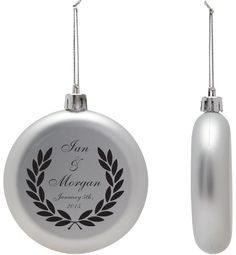 Inexpensive ornament wedding favors:  acrylic flat personalized ornaments with the name of the bride and groom.