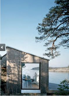 This modestly scaled vacation retreat designed by Claesson Koivisto Rune is located in the Stockholm archipelago, for a young family. Only 8 meters uphill is a neighboring house, leading to the decision for a completely Architecture Durable, Nature Architecture, Scandinavian Architecture, Architecture Design, Stockholm Archipelago, Swedish Cottage, Retreat House, Cabins In The Woods, The Ranch