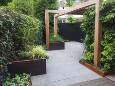 The wooden pergola is a good solution to add beauty to your garden. If you are not ready to spend thousands of dollars for building a cozy pergola then you may devise new strategies of trying out something different so that you can re Small Gardens, Outdoor Gardens, Tropical Gardens, Garden Structures, Outdoor Structures, Building A Pergola, Wooden Pergola, Pergola Designs, Pergola Ideas