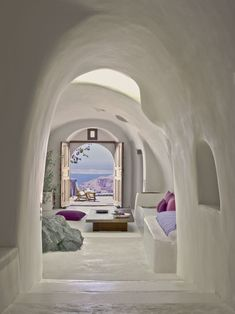 White interior, Suite at Perivolas Hotel in Santorini, will be great to have living room like this