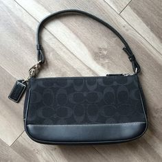 Small black fabric and leather coach purse Like new condition, used maybe twice, cloth top with signature C design with leather bottom and strap, inner pocket, 9 in x 5.25 in Coach Bags Mini Bags