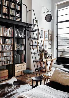"The steel bookcase with ladder is both functional and a signature piece; the Victorian clock underlines the ""public space"" feel."