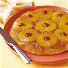 "This old-fashioned upside down cake recipe features pineapple slices that are browned in butter in the bottom of the skillet and then topped with a rich cake batter.  This recipe also offers an ""express"" version that uses cake mix."