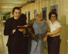 George Stover (as the prison chaplain) and Divine (as Dawn Davenport) in John Waters' Female Trouble, 1974