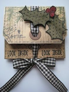 love these holly leaves!  Wendy Vecchi turns a manila tag into a cash envelope