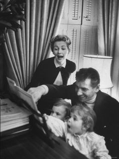 Leonard Bernstein and family singing at the piano.