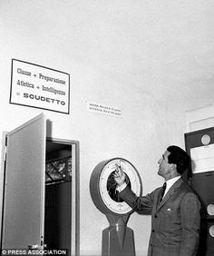 Inter Milan manager Helenio Herrera points to a sign of encouragement and motivation for his players inside the dressing room in this picture from early 1960, shortly after he joined the Italian giants. Inter finished fourth in Serie A in the 1959/60 season, with Turin giants Juventus winning the title