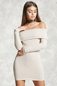 A ribbed knit dress featuring an off-the-shoulder neckline with a fold-over detail, long sleeves, and a bodycon silhouette.
