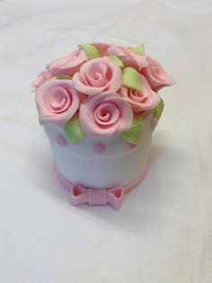 Little white flower pot cake...filled with pink rose buds