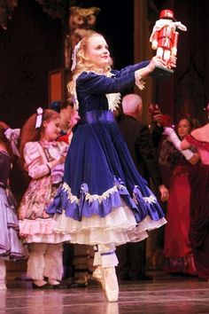 Notice shirring in overskirt (with lt. purple ruffle) and bows.